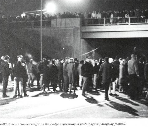 Student protestors block traffic on the Lodge freeway (1965 yearbook image).